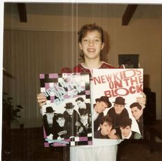posters all over the room - swoon over each of the band members -- even went to a concert --- she had a rad mom
