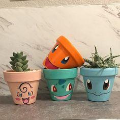 Have a favorite Pokemon? Message us on how to get your own custom Pokemon pot! Gotta Catch em All! Painted Plant Pots, Painted Flower Pots, Decorated Flower Pots, Flower Pot Crafts, Clay Pot Crafts, Flower Pot Art, Flower Pot Design, Deco Originale, Terracotta Pots