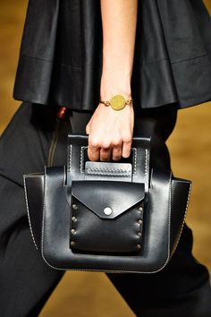 15 Runway Looks That WILL Show Up In Fast Fashion #refinery29  http://www.refinery29.com/fast-fashion-runway-trends#slide-1  Fast fashion's always doing its own affordable takes on Céline's It bags. And while we were already starting to see the resurgence of the top-handle bag, it's officially time to kiss your totes and crossbodies farewell, because these little guys are going to be a must-have come spring. Also, keep an eye out for details like contrast stitching, button-flap pockets, and…