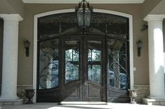 Exterior Exterior Front Door Designs for A Perfect Outer Look: Glorious Black Exterior Front Door Design Style With Full Lite Dark Bronze Wrought Double Door Also Suitable Pendant Plus Wall Lamp And Vintage Vases