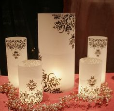 Candle Luminaries   Wedding option, but I think these could be used as home decor. http://theweddingqueen.blogspot.com/2010/02/diy-luminaries.html