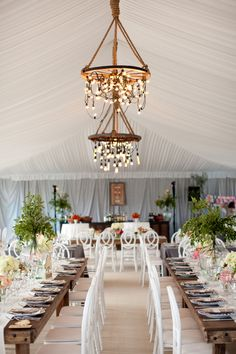 Wood tables, white chairs, and oversized glass vases. We love! Event Design: Alison Events Planning & Design