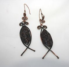 http://www.afday.com/collections/jewellery-1/products/ancient-writing-earrings