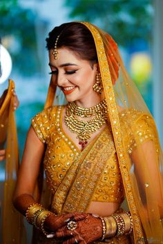 Minimalist Mumbai Wedding With A Bride In A Self-Designed Breathtaking Gold Lehenga! A Minimalist Mumbai Wedding With A Bride In A Self-Designed Breathtaking Gold Lehenga! Indian Bridal Outfits, Indian Bridal Fashion, Indian Bridal Makeup, Bridal Dresses, Bridesmaid Dresses, Designer Bridal Lehenga, Gold Lehenga, Yellow Lehenga, Indian Lehenga