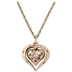 Preowned 1940s Sapphire Ruby Diamond Reversible Heart Pendant With... (12.015 DKK) ❤ liked on Polyvore featuring jewelry, pendants, blue, pendant necklaces, gold heart pendant, heart pendant, blue sapphire pendant, ruby pendant necklace and heart shaped diamond pendant