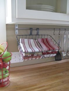 Outfitted with S-Hooks, a towel bar becomes a jack-of-all-trades in the kitchen, holding baskets and cooking tools.
