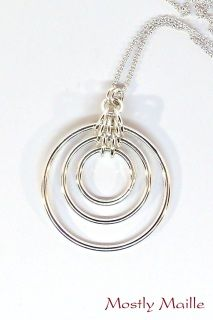 Handmade Bullseye Pendant (fused and chainmaille) Height:  2inches Width: 1 1/2inches Thickness: 3/8inch