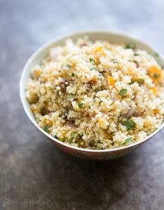 Couscous with Pistachios and Apricots ~ Do you like couscous? If so, you'll LOVE this version with pistachios and dried apricots. Beautiful and delicious! ~ On SimplyRecipes.com