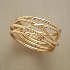 This is wider and more free form. I like the delicate lines but wider ring. This might be slightly wider than I'm looking for, but something like this where the pieces loop all the way around would be nice, possibly tapered, possibly with a stone. I like the organic look without being a direct copy of a flower or leaf or twig.