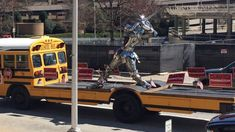 I've certainly never seen a school bus sliced and re-welded to have a big, open flat section after the first three rows of seating, but that's exactly what a Georgian gubernatorial candidate seems to have built his campaign vehicle out of... toting a statue of a knight playing baseball, no less.