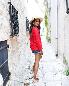 Pin for Later: 26 Stylish Red, White, and Blue Outfits That Aren't Obvious A Peasant Top, Neutral Hat, and Rolled Shorts