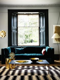 Sophisticated Living Room with Teal Sofa and Brass Accessories. Bring in the textures and pattern to zone areas and make a feature Teal Living Rooms, Living Room Sofa, Living Room Furniture, Living Room Designs, Living Room Decor, Living Spaces, Living Area, Interior Design Blogs, Interior Design Magazine