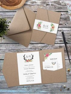 6-months before the wedding mail out your wedding invitations and RSVPs. Eco Kraft pocket fold floral antler wedding invitation.