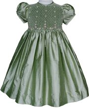 This Flower girl silk smocked dress in sage color is absolutely stunning, hand embroidered pink flowers in strands add detail to the smocked panel. Perfect for that special occasion. Made in 100% silk dupioni.