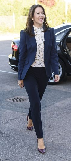 Chic: The 44-year-old royal looked effortlessly elegant as she arrived at the Roskilde Technical School on Wednesday in a tailored navy blazer and matching trousers