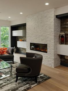 Floating Shelves On Either Side Of This White Stone Fireplace Enhance Living Rooms Contemporary Look Dark Contrasting Panels In The Inset Walls Make