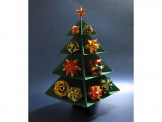 Picture of an origami Christmas tree with several origami kusudamas; Folded by Sara Adams Handmade Christmas Tree, Christmas Origami, Christmas Crafts, Xmas, Christmas Trees, Origami Models, Modular Origami, Quilling, Clock