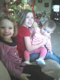 A few Christmases ago MaKayla was holding my little cousin and Callie was cheesin