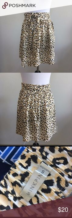 """MINKPINK : leopard print skirt Purrfectly flirty MinkPink leopard skirt. And yes, it has pockets! Belt that ties at the waist.   Condition: Preowned. No rips or stains.  Brand: MINKPINK, Originally purchased at ModCloth. Color:  White, Yellow and Black. Leopard print.  Measurements: Size small. Elastic waist provides some stretch. Length: 18""""  No holds, PayPal, or trades. Bundle to save💸. Open to offers! MINKPINK Skirts"""