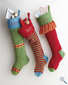 colorful hand-knit Christmas stockings. Handmade Christmas Stockings. http://www.hobbycraft.co.uk/christmas #christmas #stocking #handmadechristmas