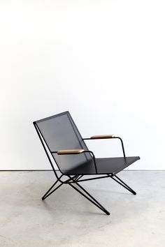 ICO - PROFILE Steel framed chair with perforated seat and wood armrest. Suitable for outside use  Size 520 x 000 x 667 mm  Materials Painted steel and oiled teak