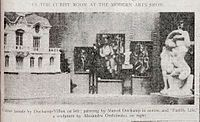 Installation shot of the Cubist room, published in the New York Tribune, February 17, 1913 (p. 7). Left to right: Raymond Duchamp-Villon, La Maison Cubiste (Projet d'Hotel), Cubist House; Marcel Duchamp Nude (Study), Sad Young Man on a Train; Albert Gleizes, L'Homme au Balcon, Man on a Balcony; Marcel Duchamp, Nude Descending a Staircase, No. 2; Alexander Archipenko, La Vie Familiale, Family Life
