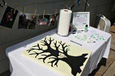 Thumb print sign in and voila' art aka family tree in this case at adoption party. These same prints could be fish in aquarium etc. for kids party/look up fingerprint art. Love it! I got the link to this party@Mattie Babb from tipjunkie.