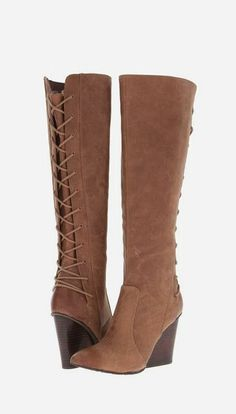 Dear lord i love wedges boots.