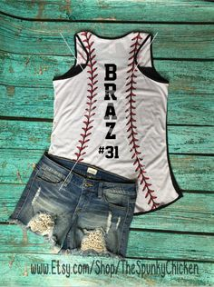 Black racerback tank top. Tank has baseball thread design on top shoulder and entire back side. So cute!!! **Baseball Aunt and Baseball Stepmom also available. Just let me know in the Notes to Seller. Choose between the following designs: 1 - Baseball mom 2 - Baseball mom w/num