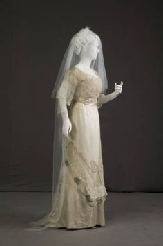 1911 silk wedding dress with original veil. Dress is quite ornate, with many rhinestones, embroidery, lace overlay, and pearls including long strands of hanging pearls (see detail pics). American.