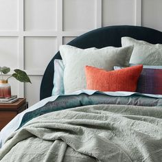 Rich in colour, the Nullarbor quilt cover will bring a restful style to any bedroom. Influenced by soft desert plains meeting the water's edge, this quilt cover is crafted from 250 thread count cotton and finished with a geometric printed reverse and filled piping trim. Coordinate with European pillowcases to complete the look. #duvetcover #doonacover #patternedbedlinen #bedding