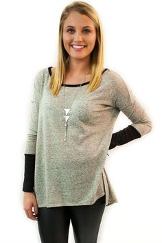 Sweater Top Grey & Black - $34.95 - Grey & Black Sweater Top – the perfect combination of a sweater and a top, perfect to keep you warm but not over do it.    | available at http://www.envyboutique.us/product/sweater-top-grey-black/ |  #Envy #Boutique #fashion #fashiontrends