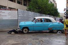 Picture of Cuban cars (Cuba): Repairing old cars in Havana