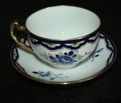 ANTIQUE NIPPON TEA CUP AND SAUCER FLOWERS/COBALT BLUE HAND PAINTED