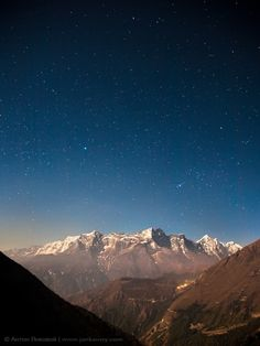 Stars above the Himilayas. The man's face stares adoringly.... See it ?!