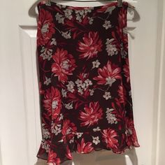 Silk Floral Ann Taylor Skirt- NEW Can you even stand the gorgeousness of this unique floral print with a flirty ruffle hem? Silk with poly lining. Side zip. Unworn with tag attached. Sorry no trades or Paypal. Thanks for shopping by! Ann Taylor Skirts