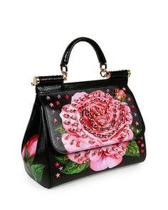 Love the way the embellishments work together with the painted rose on this Dolce & Gabbana satchel bag in rose-print leather with crystal detail Dolce & Gabbana, Dolce And Gabbana Handbags, Luxury Handbags, Purses And Handbags, Leather Handbags, Prada, Fab Bag, Chanel, Gucci