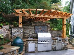 Outdoor kitchen with grill and Big Green Egg. Courtesy of Surrounding Landscapes