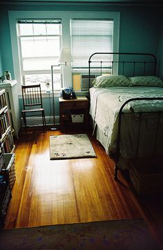 Cool, cozy bedroom & old metal bedframe.