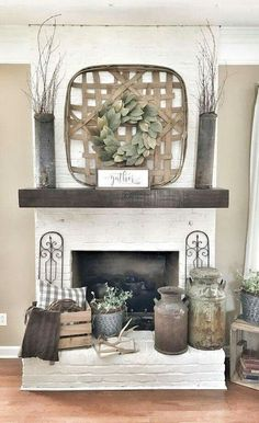 Tobacco basket over fireplace with wreath. #industrial_farmhouse_style