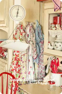 Vintage aprons in a vintage kitchen...I want these!