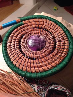 In process: Pine Needle Basket start with Amethyst center....