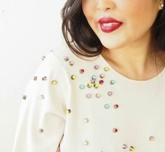 Glam up a sweater with nail polish, glue and studs.