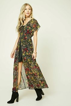 A crepe woven maxi dress featuring a floral print, V-neckline, smocked back waist, cap sleeves, and a front-slit skirt.