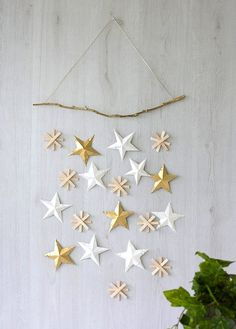 Hang this combination of stars for a simple piece of wall art this holiday season.
