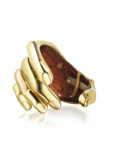 Gold tone polished bronze cuff bracelet with a unique hand design. The jewelry pieces undergo a ceramization process to preserve their brilliance and prevent oxidation. Comes in one size that's adjustable. Signature envelope included.