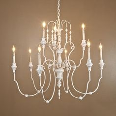 """Italian Antique Reproduction Ball andTassel Chandelier 9 lt We have the right look in antique reproductions at the right price! This 9-light two tiered Italian-inspired chandelier is finished in a shabby cream with hints of aged rust. The iron loop arms gracefully scroll out with ball accents. Carved tassels dangle delicately from the waterfall top. 9 lights (candle base socket) (37.5""""Hx40""""W)"""