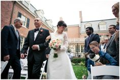 Bride walking down aisle with her dad and seeing her adorable dog!