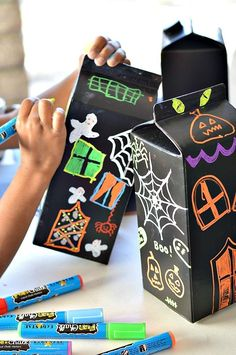 Halloween Craft making haunted houses with liquid chalk