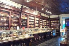 Vintage pharmacy....The mahogany cabinets, filled with vintage medications